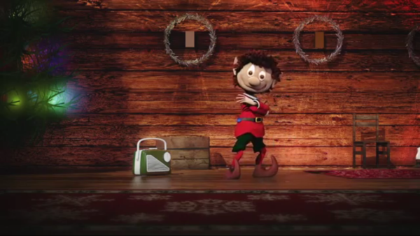 Elfin the magical Christmas elf dances in Santa's grotto