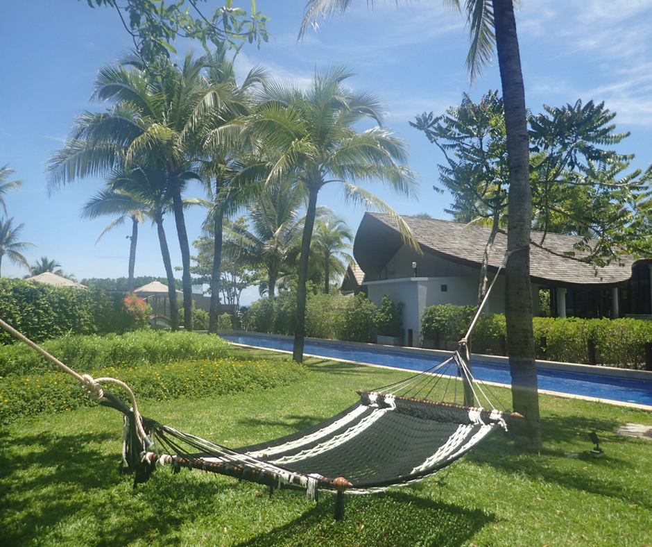 You can relax in this hammock by the pool while your kids enjoy the kids club (pictured in the background)
