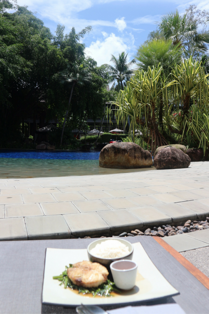 Grilled fish and rice by the swimming pool